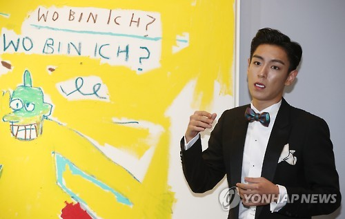 In this file photo taken on Sept. 19, 2016, T.O.P., a member of South Korean boy band BIGBANG, attends a news conference on a planned special Sotheby auction at Hotel Shilla in Seoul.  (Yonhap)