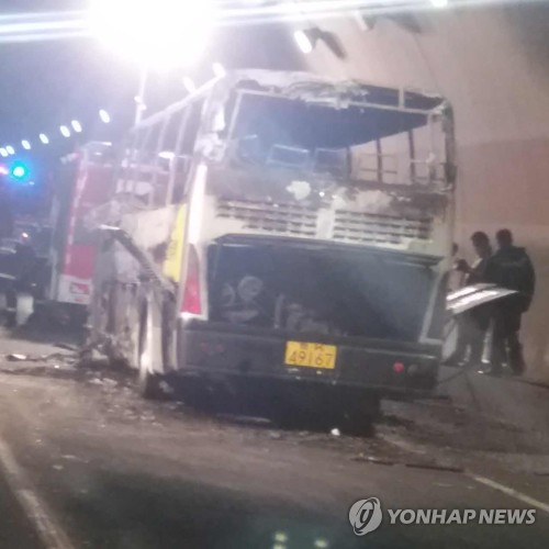 China says arson suspected in bus fire in which South Koreans died