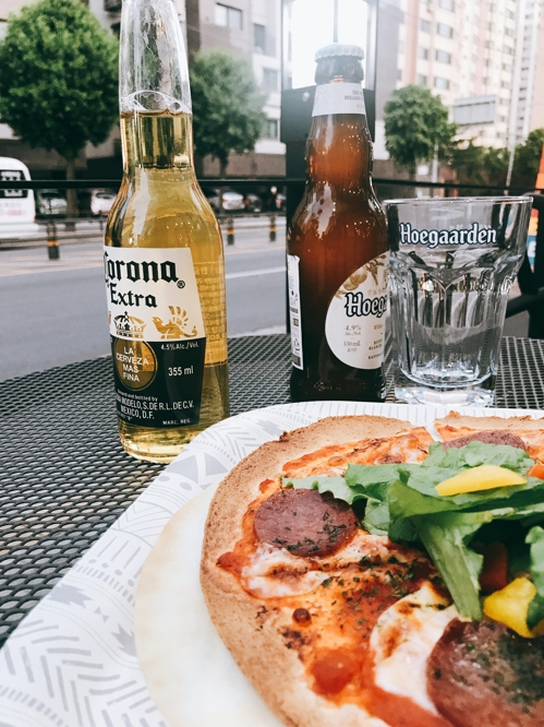 Beer and pizza are served at Cafe 468, located in a quiet residential area in Euijeongbu, just north of Seoul. (Yonhap)