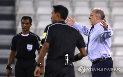 South Korea head coach Uli Stielike reacts to a play during a World Cup qualifying match against Qatar at Jassim Bin Hamad Stadium in Doha