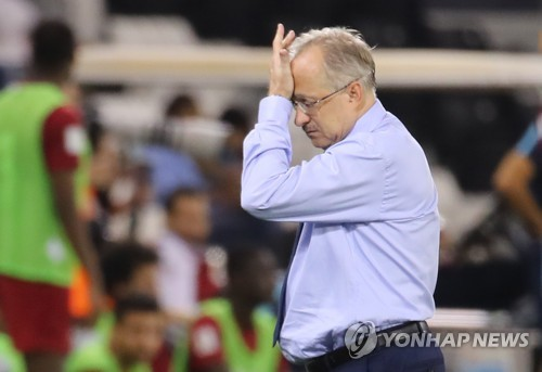 South Korea head coach Uli Stielike leaves the field after losing to Qatar 3-2 in the teams&apos World Cup qualifying match at Jassim Bin Hamad Stadium in Doha