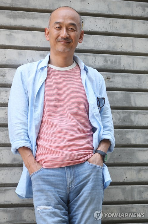 "Director Lee Joon-ik of ""Anarchist from Colony"" poses for a photo before an interview with Yonhap News Agency on June 14, 2017. (Yonhap)"