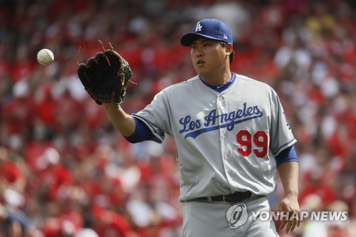In this Associated Press photo, Ryu Hyun-jin of the Los Angeles Dodgers receives the ball during his start against the Cincinnati Reds at Great American Ball Park in Cincinnati on June 17, 2017. (Yonhap)