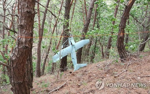 A photo, provided by South Korea's military, shows a North Korean drone found on a mountain in Inje, Gangwon Province, on June 9, 2017. (Yonhap)