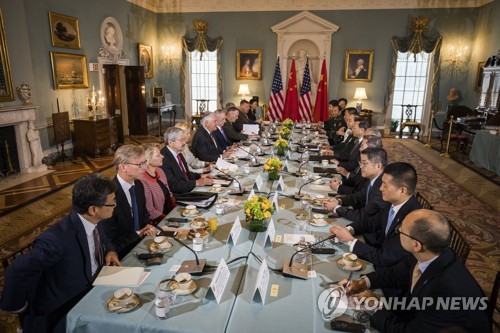 China, US agree on more cooperation during security talks