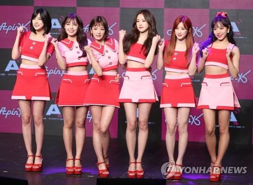 """K-pop girl group Apink pose for the camera during a media showcase for its latest album """"Pink Up"""" on June 26, 2017, at the Shinhan FAN Square hall in western Seoul. (Yonhap)"""