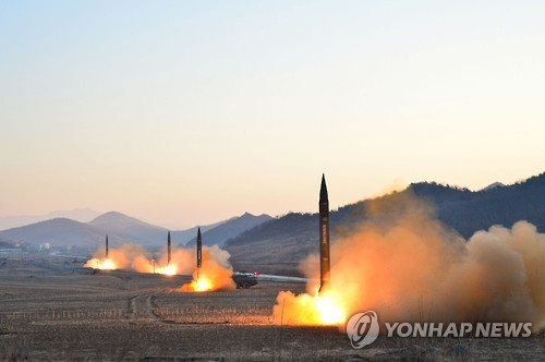 This file photo carried by North Korea's state news agency on March 7, 2017, shows North Korean missile launches under the observance of its leader Kim Jong-un. (For Use Only in the Republic of Korea. No Redistribution) (Yonhap)
