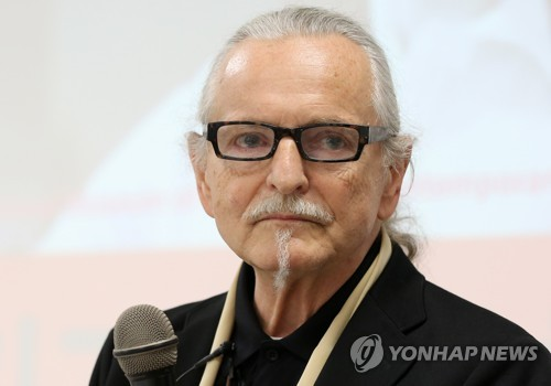 "Polish artist Krzysztof Wodiczko listens to a reporter's question during the press briefing for his major retrospective ""Krzysztof Wodiczko: Instruments, Monuments, Projections"" at the National Museum of Modern and Contemporary Art (MMCA) in Seoul on July 4, 2017. (Yonhap)"