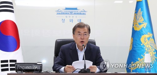 This photo taken on July 4, 2017, shows South Korean President Moon Jae-in chairing an emergency meeting of the National Security Council (NSC). (Yonhap)