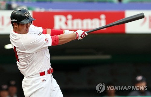 In this file photo taken on June 15, 2017, Choi Jeong of the SK Wyverns launches a three-run home run against the Hanwha Eagles in the teams&apos; Korea Baseball Organization game at</p><p>Incheon SK Happy Dream Park. (Yonhap)