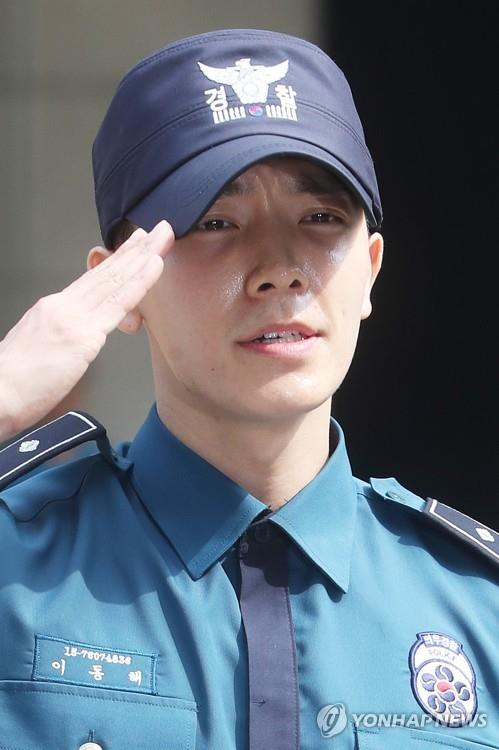 Donghae, a member of the South Korean boy group Super Junior, salutes during a ceremony at Seoul Metropolitan Police Agency on July 14, 2017, to mark his departure from the military service as a conscripted policeman. (Yonhap)