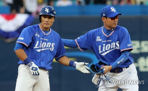 Lee Seung-yuop of the Samsung Lions (L) celebrates his double during the annual Korea Baseball Organization All-Star Game at Daegu Samsung Lions Park in Daegu on July 15, 2017. (Yonhap)