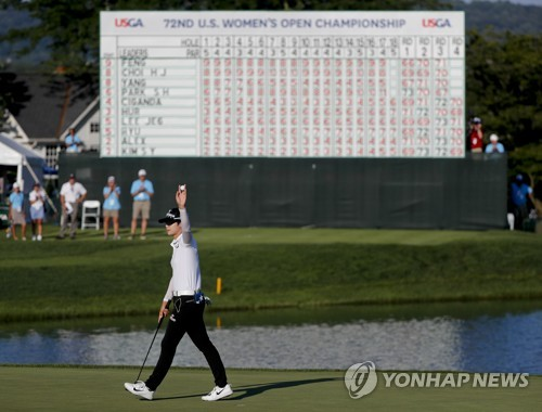 Park Sung-hyun of South Korea celebrates after making par at the 18th hole during the final round of the U.S. Women's Open at Trump National Golf Club in Bedminster New Jersey