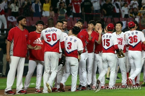 Players of the Kia Tigers celebrate their 7-1 victory over the NC Dinos in their Korea Baseball Organization game at Gwangju-Kia Champions Field in Gwangju on July 13, 2017. (Yonhap)