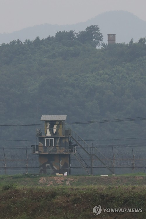 A South Korean sentry post (front) stands by a barbed wire fence at the Demilitarized Zone separating the two Koreas</p><p>near Paju, north of Seoul, on July 17, 2017, with a North Korean sentry post (above) seen in the background. (Yonhap)