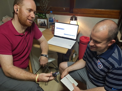 Andrew Farrell (L) and Brian Richards record an episode of their weekly podcast on the Korea Baseball Organization for their Grand Slam KBO website in Seoul on July 17, 2017, in his photo provided by Richards. (Yonhap)