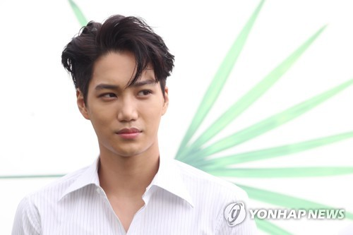 "Kai, a member of the K-pop boy group EXO, listens to a reporter's question during a press conference for its fourth album ""The War"" at Grand Walkerhill hotel in eastern Seoul on July 18, 2017. (Yonhap)"