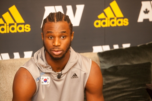 In this photo provided by Adidas Korea on July 23, 2017, Andrew Wiggins of the Minnesota Timberwolves in the National Basketball Association speaks to reporters in a group interview at a Seoul hotel. (Yonhap)