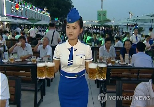 This image captured from footage aired by North Korea's state TV station on Aug. 13, 2016, shows the country's first Pyongyang Taedonggang Beer Festival. (For Use Only in the Republic of Korea. No Redistribution) (Yonhap)