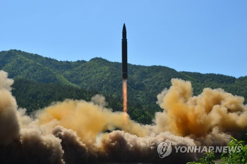 This file photo carried by North Korea's state media shows North Korea's test-firing of an intercontinental ballistic missile on July 4, 2017. (For Use Only in the Republic of Korea. No Redistribution) (Yonhap)