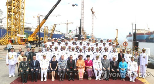 In this photo provided by Daewoo Shipbuilding & Marine Engineering Co., participants at a delivery ceremony of a submarine pose for a photo at its shipyard on Geoje Island, off the country's southern coast on Aug. 2, 2017. The shipbuilder handed over the submarine to Indonesia, becoming the first South Korean company to export a submarine. (Yonhap)