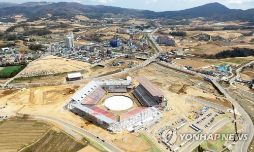 """This is an aerial view of a stadium, dubbed """"Olympic Plaza,"""" under construction where the opening and closing ceremonies of the 2018 PyeongChang Winter Olympic Games will be held. The facility is scheduled to be completed by the end of August. (Yonhap)"""