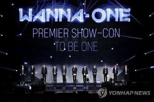 """In this file photo, boy band Wanna One perform on stage during a debut showcase at Gocheok Sky Dome in Seoul on Aug. 7, 2017. The group was established through the 2017 series of Mnet's survival competition program """"Produce 101 Season 2."""" (Yonhap)"""