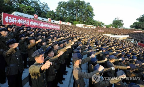 North Koreans hold a rally in Pyongyang on Aug. 11, 2017, to support their government's vow to retaliate against the U.S. (KCNA-Yonhap) (For Use Only in the Republic of Korea. No Redistribution)