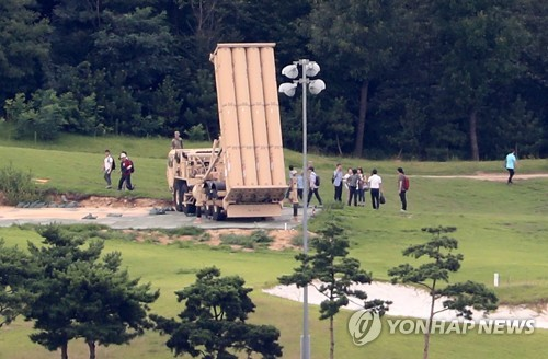 Officials from the defense and environment ministries measure electromagnetic radiation and noise from the site of the THAAD deployment in Seongju, some 300 kilometers south of Seoul, on Aug. 12, 2017, as part of the environmental survey on the controversial U.S. missile defense system. (Yonhap)