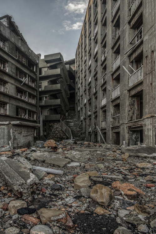 "Rubble litters the street in front of the ""Stairway to Hell"" on Hashima Island in this photo taken in July 2008. This photo was provided by South Korean photographer Lee Jae-gab. (Yonhap)"