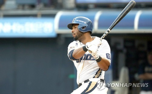 In this file photo taken on Aug. 1, 2017, Xavier Scruggs of the NC Dinos gets a hit against the Hanwha Eagles in their Korea Baseball Organization game at Masan Stadium in Changwon, South Gyeongsang Province. (Yonhap)
