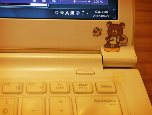 This photo, provided by Suh Jie-eun, shows her laptop computer with a sticker of Rilakkuma, a popular bear character by Japan's San-X. (Yonhap)