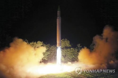 North Korea launches 'projectile' thought to be ballistic missile
