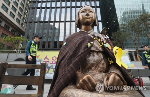 "A bronze statue symbolizing ""comfort women"" victims stands near Seoul-based Japanese Embassy in this file photo taken on April 25, 2017. (Yonhap)"
