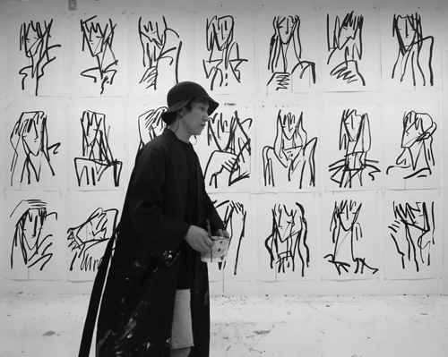 This undated photo provided by artist Kim Hee-soo is of himself in front of his drawings. (Yonhap)