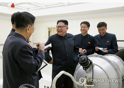North Korean leader Kim Jong-un (C) visits the country's Nuclear Weapons Institute in a photo released by Pyongyang's state media on Sept. 3, 2017. (Yonhap) [For Use Only in the Republic of Korea. No Redistribution]