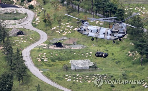 A U.S. military chopper delivers a supply of goods to the THAAD base in Seongju North Gyeongsang Province on Sept. 2 2017