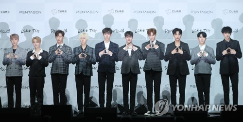 """Boy band Pentagon poses for the camera at a media showcase in Seoul on Sept. 6, 2017, on the release of the group's fourth mini album """"DEMO_01"""" at Yes24 Live Hall in eastern Seoul. (Yonhap)"""