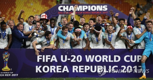 In this file photo taken June 11, 2017, England national football team players celebrate after winning the FIFA U-20 World Cup in South Korea. (Yonhap)