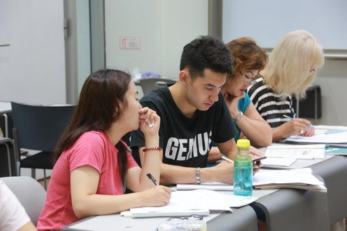 This photo provided by the Overseas Koreans Foundation shows Viacheslav Li (2nd from L) studying along with other classmates during a Korean language class. (Yonhap)