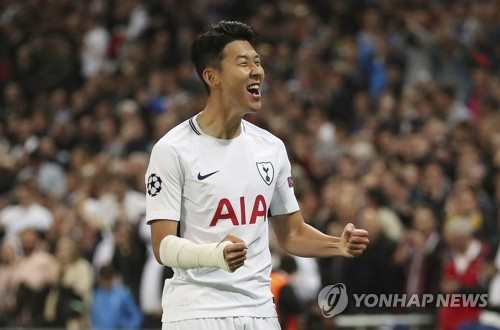 In this photo released by The Associated Press on Sept. 13, 2017, Tottenham Hotspur's Son Heung-min celebrates after scoring a goal during the UEFA Champions League Group H match between Tottenham and Borussia Dortmund at Wembley Stadium in London. (Yonhap)