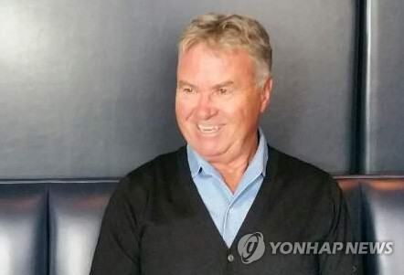 In this file photo taken Sept. 14, 2017, former South Korea football coach Guus Hiddink smiles during a press conference at a hotel in Amsterdam. (Yonhap)