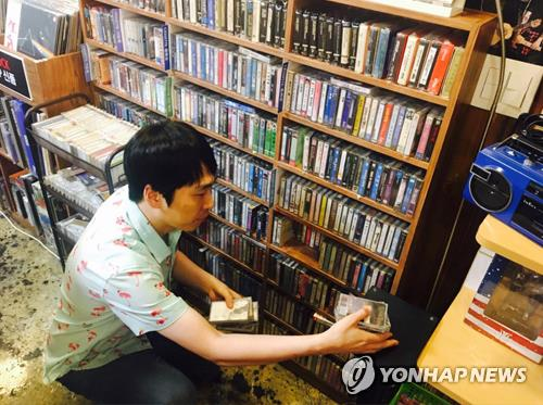 Kim Yun-jung, owner of the independent music store Dope Records in western Seoul, checks the inventory of new cassette tapes on Sept. 25, 2017. (Yonhap)
