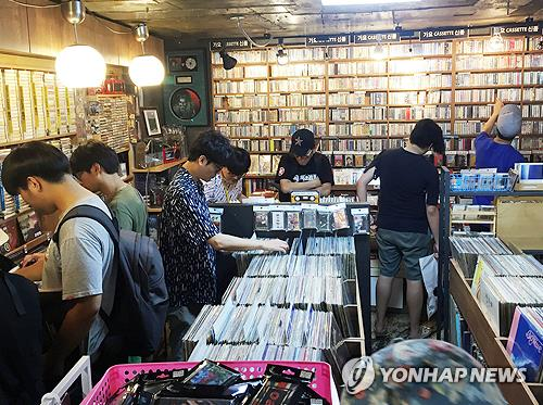Shoppers are seen searching for rare cassette tapes at Dope Records, in this undated photo provided by the store. (Yonhap)