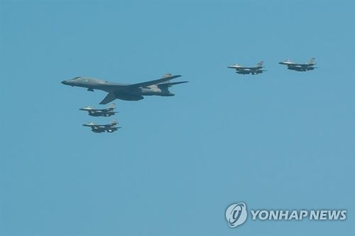A B-1B bomber flies, accompanied by fighter jets, in this file photo posted on the U.S. Air Force's website. (Yonhap)