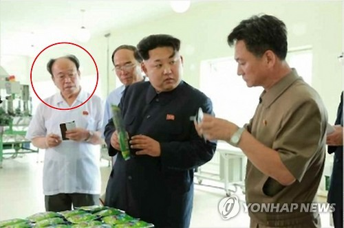 This photo carried by North Korea's media on July 11, 2015, shows Jon Il-chun (red circle), the head of Office 39, the ruling party's special unit managing state coffers. (For Use Only in the Republic of Korea. No Redistribution) (Yonhap)