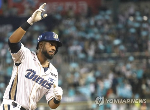 Xavier Scruggs of the NC Dinos celebrates his two-run home run against the Lotte Giants in the bottom of the first inning in Game 3 of the clubs' first round Korea Baseball Organization postseason series at Masan Stadium in Changwon, South Gyeongsang Province, on Oct. 11, 2017. (Yonhap)