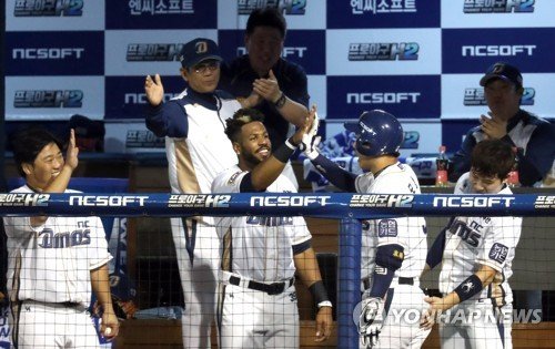 NC Dinos players celebrate a solo home run by Mo Chang-min (in helmet, second from R) against the Lotte Giants in the bottom of the sixth inning in Game 3 of the clubs' first round Korea Baseball Organization postseason series at Masan Stadium in Changwon, South Gyeongsang Province, on Oct. 11, 2017. (Yonhap)