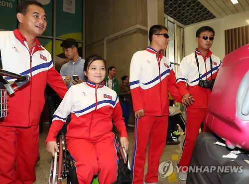In this file photo taken on Sept. 4, 2016, North Korean Paralympic athlete Song Kum-jong (2nd from L) and officials arrive at Galeao Airport in Rio de Janeiro to compete at the 2016 Rio Paralympic Games. (Yonhap)