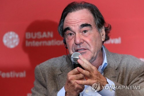 American director Oliver Stone answers questions from reporters during a news conference at the 22nd Busan International Film Festival in Busan on Oct. 13, 2017. (Yonhap)
